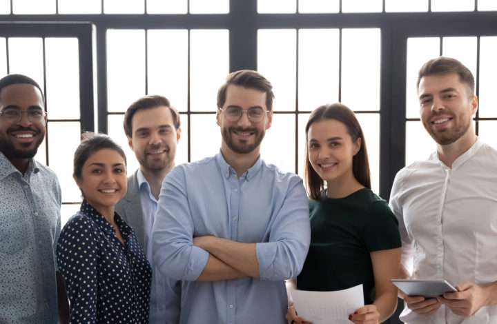 Group portrait of successful multiethnic business team in office
